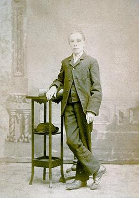 Photo of John F. Caris about age 13