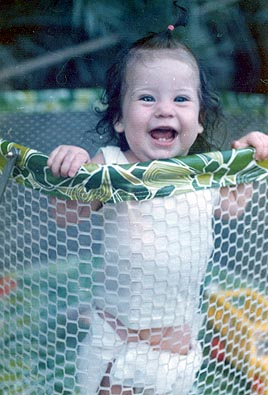 Picture of Maryhelen Arnold, playing outside in playpen on Grand Turk Island, Turks and Caicos, BWI  1974