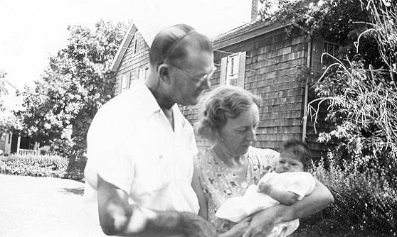 Picture of Sandra Lee Willis, age 6 weeks, held by grandmother Hilda G. Willis with grandfather L. Roy Willis, Sr. looking on, Easton, Maryland August 1941